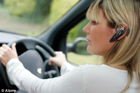 Lady using bluetooth wireless while driving