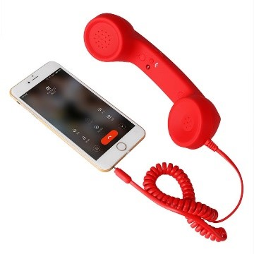 Smartphone connected with a telephone via cord